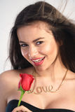 Young woman holding a red rose Royalty Free Stock Photo