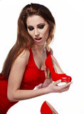 Young woman holding a red shoe Stock Images