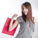 Young Woman Holding Red Shopping Bag Stock Images