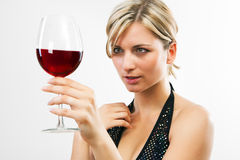 Young woman holding red wine Royalty Free Stock Photography