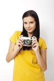 Young Woman Holding retro camera against white background Royalty Free Stock Photography