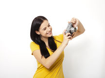 Young Woman Holding retro camera against white background Royalty Free Stock Photo