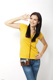 Young Woman Holding retro camera against white background Stock Images
