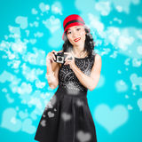 Young woman holding retro camera on blue Royalty Free Stock Images