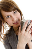 Young woman holding a retro-microphone. stock image
