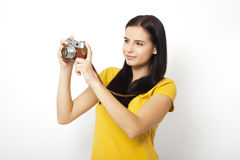 Young Woman Holding retrocamera against white background Stock Photo