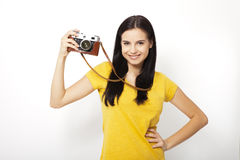 Young Woman Holding retrocamera against white background Stock Photography