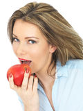 Young Woman Holding a Ripe Juicy Red Apple Stock Images