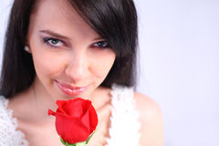 Young woman holding a rose. Sexy woman holding a red rose Royalty Free Stock Photos