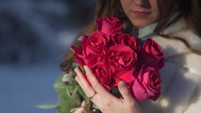 Beautiful young woman holding rose flowers closeup stock video footage