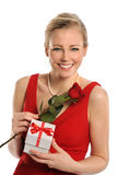 Young Woman Holding Rose and Gift Royalty Free Stock Photo