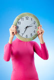 Young woman holding round clock Royalty Free Stock Images