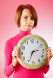 Young woman holding round clock Stock Photography