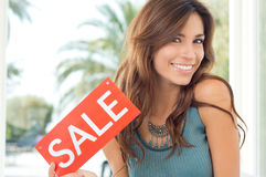 Young Woman Holding Sale Board Royalty Free Stock Photo