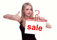 Young woman holding a sale sign Royalty Free Stock Photos