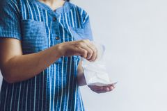 Young woman holding sanitary pads. Period days concept showing feminine menstrual cycle. Young woman holding sanitary napkins. Period days concept showing royalty free stock photos