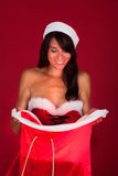 Young Woman Holding Santa Bag Stock Images