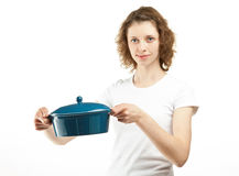 Young woman holding saucepan Stock Images