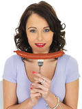 Young Woman Holding a Saveloy Sausage Royalty Free Stock Photo