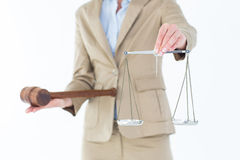 Young woman holding scales of justice and a gavel Stock Photos