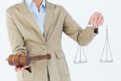 Young woman holding scales of justice and a gavel Royalty Free Stock Photo