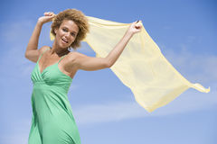 Young woman holding scarf Royalty Free Stock Photos