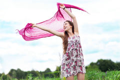 Young woman holding scarf to wind Royalty Free Stock Images