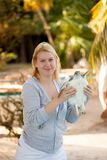 Young woman holding sea turtle in hands. At the beach royalty free stock photos