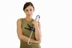 Young woman holding sealant gun, cut out Royalty Free Stock Image