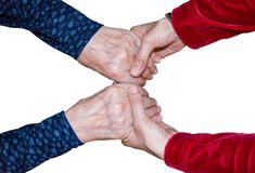 Holding Hand, Helping, Giving Support. Young woman is holding senior womans hands. Helpinng concept. Helping lonely old people Royalty Free Stock Photo