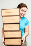 Young woman holding several boxes Stock Photo