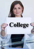 Young woman holding a sheet of paper with the text college Stock Image