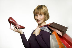 Young woman holding shoe Royalty Free Stock Images