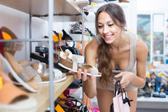 Young woman holding shoes Stock Images