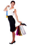 Young woman holding a shopping bag Royalty Free Stock Photography