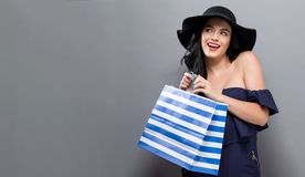 Young woman holding a shopping bag Royalty Free Stock Photo