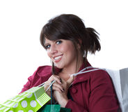 Young woman holding shopping bags. Isolated on a white background Royalty Free Stock Photography