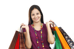 Young woman holding shopping bags. Against a white background Stock Photography