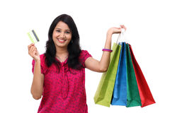 Young woman holding shopping bags and credit card Stock Photo