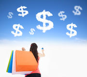 Young woman holding shopping bags and credit card royalty free stock photo