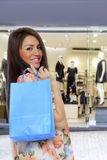 Young woman holding shopping bags. In front of the store Royalty Free Stock Photo