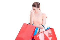 Young woman holding shopping bags having headache or being stres Stock Images