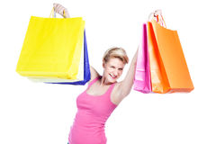 Young woman holding shopping bags. Isolated on white Royalty Free Stock Photo