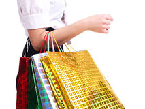 Young woman holding shopping bags. Young woman holding shopping bags isolated on a white background Royalty Free Stock Image