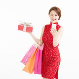 Young  woman holding shopping bags and smart phone Royalty Free Stock Photos