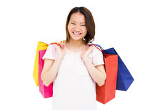 Young woman holding shopping bags Stock Images