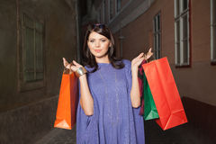 Woman holding colorful bags Stock Photography