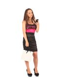 Young woman holding shopping bags and talking on a mobile phone Royalty Free Stock Images