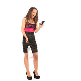 Young woman holding shopping bags and talking on a mobile phone Royalty Free Stock Photography
