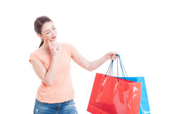 Young woman holding shopping bags and thinking Stock Photography